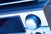 Closeup of a hifi system in blue tone