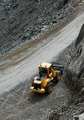 Construction machine in a dark rocky area