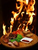Barbecue Meal Of Shish Kebab And Sausages With Vegetables. Grilled Meat Served With Barbecue Sauce.  poster