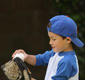 Hispanic Boy Playing With Baseball And Glove
