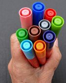 Coloured Pens In A Fist.