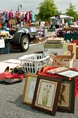 Bargain Hunters Look Over Merchandise At City Garage Sale