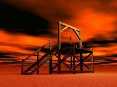 stock photo of gallows  - Medieval gallows made of wood by red cloudy night - JPG