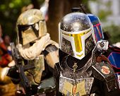 A Star Wars fan dressed as Boba Fett marches in the annual DragonCon parade
