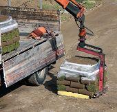 Unloading Rolls of turf