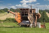 Old harvester near the field