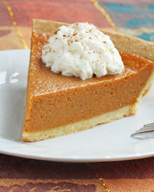 image of pumpkin pie  - pumpkin pie with whipped cream served on white plate - JPG