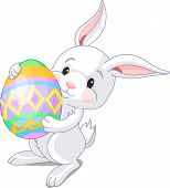 picture of easter bunnies  - Illustration of happy Easter bunny carrying egg - JPG