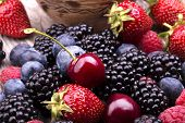 stock photo of berries  - tasty summer fruits on a wooden table - JPG