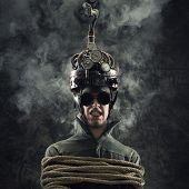 stock photo of experiments  - Man wearing a brain - JPG