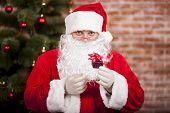 Santa Claus Brings Christmas Gift