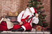 Santa Claus Plays The Guitar