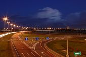 Ringway St Petersburg. Russian Road At Night, With Markings, Road Signs And Lighting Masts.