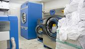 stock photo of laundry  - Laundry room washing machines and other electronic devices - JPG
