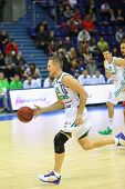 MOSCOW - SEP 29: Sportsman from Zalgiris (Lithuania, in white) team runs basketball in tournament fo
