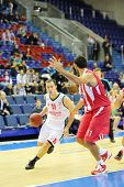MOSCOW - SEP 29: Basketball players Olympiakos (Greece) and Lokomotiv-Kuban (Russia, in white) play