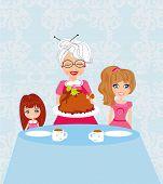 Grandma Bringing Thanksgiving Turkey To The Dinner Table