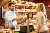 stock photo of cashiers  - Young girl in a bakery - JPG