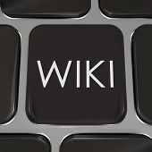 The word Wiki on a computer keyboard to illustrate a website or internet page where users can edit o