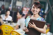 foto of chinese menu  - Chinese young waitress girl of street restaurant in china with menu waiting an order - JPG