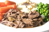 picture of pot roast  - pot roast dinner green peas baby carrots mashed potatoes gravy - JPG