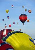 Colouful hot air balloons rising at the Bristol Balloon Fiesta, UK 8/8/09