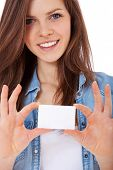 stock photo of scandinavian descent  - Attractive teenage girl holding blank business card - JPG