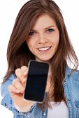 Attractive teenage girl holding mobile phone. All on white background.