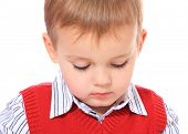Cute little boy looking down. All on white background.