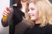 foto of hairspray  - Girl with blond wavy hair by hairdresser - JPG