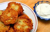 potato pancakes on plate with sour cream
