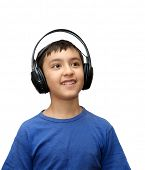 boy listening music in headphones isolated on white