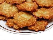 heap of potato pancakes on plate