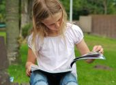 Young Girl Reading Magazine
