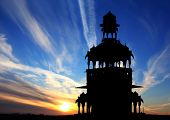 cenotaph silhouette against beautiful sunset in India