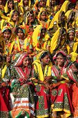 PUSHKAR, INDIA - NOVEMBER 21: Group of Indian girls in colorful ethnic attire attends at Pushkar cam