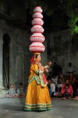 UDAIPUR, INDIA - NOVEMBER 24: Bhavai performance - famous folk dance of Rajasthan state. Performer b