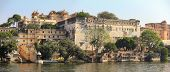 palace and lake in Udaipur India - view from boat