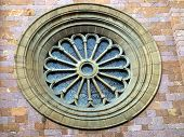 Rosette Or Circular Window Filled With Stained Glass And Ornamentation In The Facade