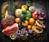 stock photo of dragon fruit  - Exotic fruits variety still life on vintage wooden boards - JPG