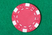 Red Poker Chip On The Casino Table