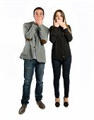 Couple Surprised Over White Background