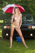 Model With A Modern Muscle Car