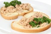 Tasty sandwiches with tuna and cod livers, isolated on white