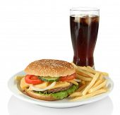 Tasty cheeseburger with fried potatoes and cold drink, isolated on white