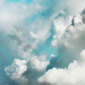 Illustration of thick cumulus clouds in turquoise sky