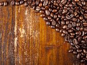 Background Of Freshly Dark Roasted Coffee Beans
