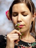 Beautiful Girl Smelling A Cuckoo Flower In The Spring (focus On The Flower)