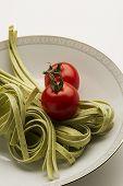 Tagliatelli Pasta And Fresh Tomatoes