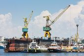 Towboats And Cranes In Shipyard
